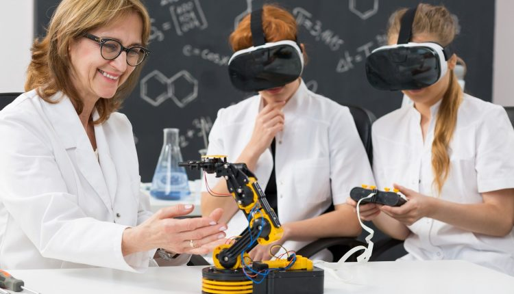 professor-and-two-science-students-wearing-vr-gogg-P6CNPLH-compressor